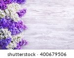 Lilac Flower On Wood Backgroun...