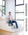 portrait of happy man sitting...   Shutterstock . vector #400680808