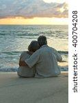elderly couple rest at tropical ... | Shutterstock . vector #400704208
