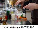bartender coocks cocktail...   Shutterstock . vector #400719406