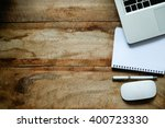 office wood table with notepad... | Shutterstock . vector #400723330