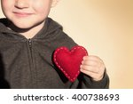 Red Heart In Child Hands....