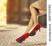 woman legs and heels  | Shutterstock . vector #400739590