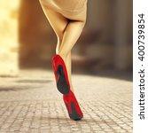 brown street and woman legs  | Shutterstock . vector #400739854