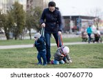young mother walking with her... | Shutterstock . vector #400760770