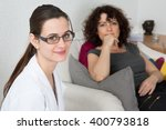 therapist listening to her... | Shutterstock . vector #400793818