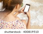 Woman Holding Smartphone In...