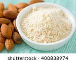 Small photo of almond flour on wooden surface