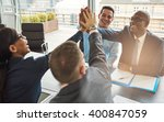 exultant team of multiracial... | Shutterstock . vector #400847059
