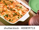 dish with the baked potatoes on ... | Shutterstock . vector #400859713