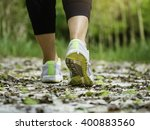 Woman Walking On Trail Track...