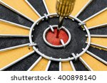 Small photo of Close up dart target with arrow hitting on bullseye in dartboard, Smart goal setting and marketing business concept, abstract background
