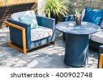 outdoor patio with empty chair... | Shutterstock . vector #400902748