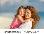 portrait of mother and little... | Shutterstock . vector #400922374