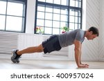 athletic middle age man doing... | Shutterstock . vector #400957024
