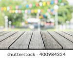 empty wooden table with blurred ... | Shutterstock . vector #400984324