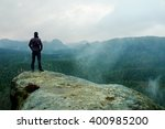 Hiker On Sharp Cliff Of...