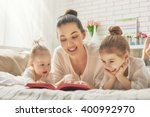 happy loving family. pretty... | Shutterstock . vector #400992970