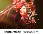 musician play violin on dark... | Shutterstock . vector #401020474