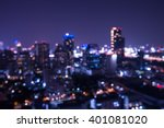 Small photo of Abstract urban night light bokeh defocused background