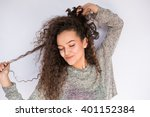 happy and dancing young woman... | Shutterstock . vector #401152384