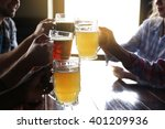 friends drinking beer in pub | Shutterstock . vector #401209936