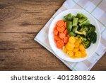 Steamed Vegetables On Wooden...