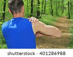 Small photo of Sport injury, Man with shoulder pain