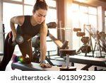 fitness girl lifting dumbbell... | Shutterstock . vector #401309230