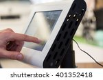 Small photo of A finger touching a thick touch screen device