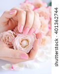 hands of a woman with pink... | Shutterstock . vector #401362744