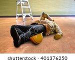 injured worker after falling... | Shutterstock . vector #401376250