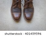 brown leather shoes on gray... | Shutterstock . vector #401459596