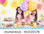 two little girls with balloons...