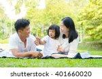 Asian Family Enjoying Outdoor...
