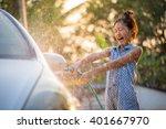 Happy Asian Girl Washing Car O...