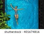 woman in pool water. beautiful... | Shutterstock . vector #401674816