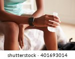 Young Black Woman Holding...