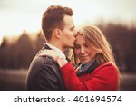 beautiful young couple outdoors.... | Shutterstock . vector #401694574