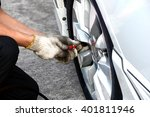 filling air into a car tire | Shutterstock . vector #401811946