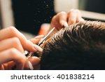 Brunette Man Getting A Haircut...
