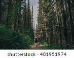 girl hiking into canadian... | Shutterstock . vector #401951974
