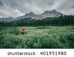 gilr hiking into into canadian... | Shutterstock . vector #401951980