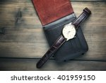 elegant watch and wallet on... | Shutterstock . vector #401959150