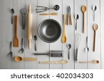 glass bowl and kitchen cutlery... | Shutterstock . vector #402034303