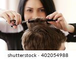 professional hairdresser making ... | Shutterstock . vector #402054988
