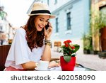 happy woman talking the phone... | Shutterstock . vector #402058090