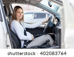 pregnant woman driving her car  ... | Shutterstock . vector #402083764