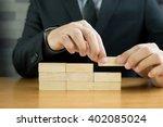 hand of businessman arrange...   Shutterstock . vector #402085024