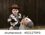 Little Boy With Cowboy Hat On...